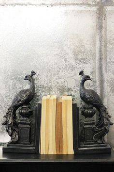 The Set of 2 Regal Standing Peacock Bookends feature a peacock stood on an ornamental pedestal on each end They are made from resin and painted