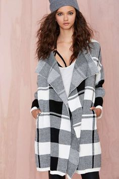 Everyone's going to be checking you out in this black and white sweater coat.