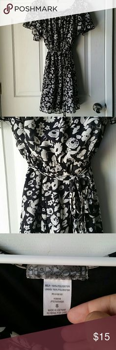 Fishbowl Knee length dress Breezy knee length dress. Light sheer bird/flower pattern fully lined. Short sleeves with great movement. Elastic at waist with 2 coordinating ribbon to tie around waist for another added detail. fishbowl Dresses