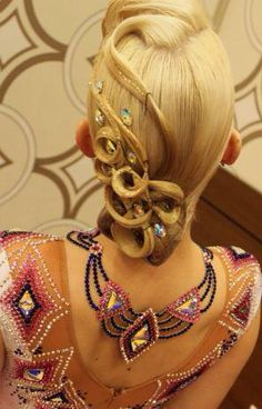 Complex ballroom hair with swirls to match the dress. Visit http://ballroomguide.com/comp/hair_make_up.html for more hair and makeup info