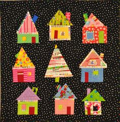 """From """"Fun with Barb,"""" I love this fun quilt she's called """"Whooville."""" She's used selvages to outline some of the roofs, houses, and windows, as well as to construct a tree. Clever and cute!"""