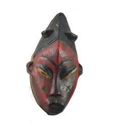 During the ancient times in Africa before the passports were used, Africans used colorful masks to identify their tribes or countries of origin when travelling across the continent. You will notice cheek marks on this mask called scarification. Some tribes still practice this by beautifying themselves by permanently scaring the skin.