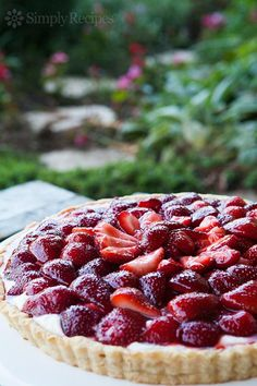 Tart with fresh strawberries, macerated in sugar, over a creamy mascarpone base and brushed with a balsamic glaze. #Easter ~ SimplyRecipes.com