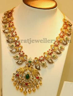 Pachi design and antique work mango necklace with rubies adorned flowers. Paisley design diamond motifs attached in the bottom with peaco. Indian Wedding Jewelry, Indian Jewelry, Bridal Jewelry, Indian Bridal, Indian Jewellery Design, Jewelry Design, Latest Jewellery, Designer Jewelry, Mango Necklace
