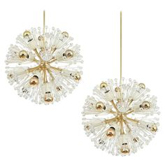 Pair of Emil Stejnar Starburst Brass and Glass Chandeliers | See more antique and modern Chandeliers and Pendants at http://www.1stdibs.com/furniture/lighting/chandeliers-pendant-lights