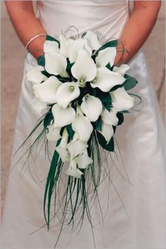 calla lily bouquets -you could do white for bride and mixed colors (purple, yellow, red, orange and white for bridesmaids).