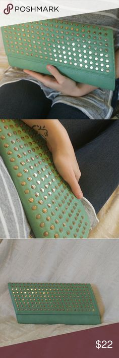 Vegan Studded Clutch Seafoam green, golden studs, and a funky parallelogram shape. Soft vegan leather! Has golden chain for option of cross-body/over shoulder wear. Never used, NWOT, was a bit to small to accommodate my massive wallet! Two small manufacturer's flaws on back (see last pic [small black mark, wonky stitching]). Urban Expressions Bags Clutches & Wristlets
