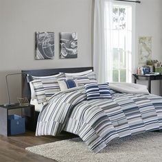 Spuce up your bedroom with the hip Emmett Comforter Set. A broken stripe pattern covers this top of bed in urban shades of blue and grey for the modern punch your space needs. Two decorative pillows use corresponding colors to complete this look.