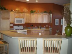 Terracotta Kitchen, Just painted the kitchen with a rich terracotta paint, to replace the builder's white. It's called Red Scent by Sherwin Williams. I love the contrast with the maple cabinets., Kitchens Design