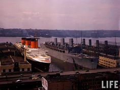 New York Harbor, 1940. The interned French liner Normandie and RMS Queen Mary and Aquitania already in their war colors.