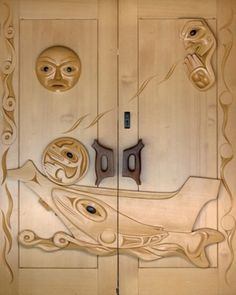 Tseshaht Administration doors, yellow cedar and yew wood carved by Gordon Dick