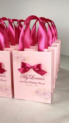 Elegant Birthday party gift bags with hot pink satin ribbon handles, roses and custom name. Personalized birthday party favors make a unique way to thank guests for attending your special day. #welcomebag #giftbox #personalizedgift #elegantgift #partyfavors #birthdayparty #annyversarygift #birthdaygift #giftbags #birthdaycelebration #elegantbag #30thbirthday #40thbirthday #10thbirthday #20birthday #birthdayfavors #elegantbirthday #pinkparty