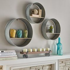 IMAX Laurel Round Wall Shelves Set of 3 There's a time for every re-purpose. This trio of round wall shelves makes the most of the found-object look with its combination of wood plank shelves and galvanized metal mesh frames. Wood Plank Shelves, Metal Shelves, Shelves In Bedroom, Diy Wall Shelves, Shelving Ideas, Book Shelves, Diy Apartment Decor, Diy Home Decor, Round Shelf