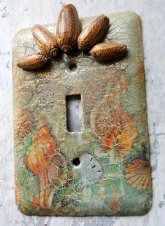 Seashells, mixed media light switch cover, collage, sea foam green, peach, beige, seashells at top