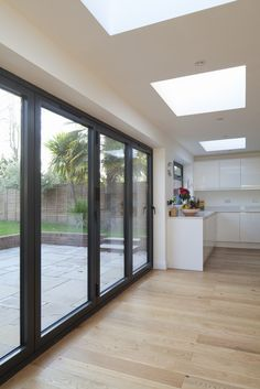 Rear flat roof extension | Black aluminium bi-fold doors to open plan living | Square flat rooflights | Brighton Architects