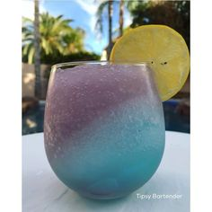 Mermaid Mixer Cocktail - For more delicious recipes and drinks, visit us here: www.tipsybartender.com