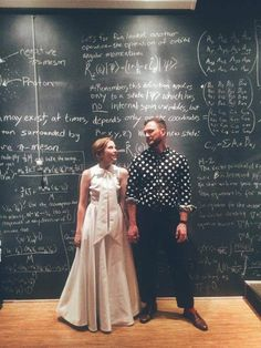The groom's polka-dotted shirt, the science-themed temporary tattoos, the giant chalkboard wall full of Feynman Lectures, the astronaut ice cream favors, the bride's retro dress -- these are a few of my favorite things. Ground control to Major Tom: commencing countdown, engines on. Liftoff and see this science and 1960s mod wonderland of a wedding!
