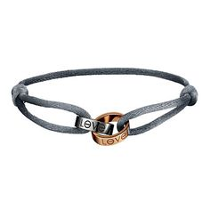 Cartier Love Charity bracelet with 18kt rose-and white-gold rings on a gunmetal silk cord. The cord color was chosen by Janet Jackson to benefit the Ovarian Cancer National Alliance.