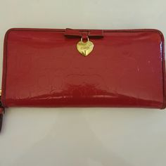 Coach embossed wallet Gently used,  excellent condition,  matches several purses in my closet!  No bundles on any coach or kate spade items. Coach Bags Wallets