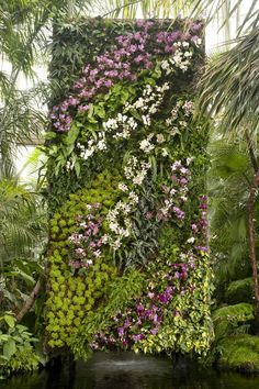 Vertical Gardens Patrick Blanc vertical garden wall - orchides - Blooming on everything from fabric to fine china, orchids are the most intoxicating flowers of the season. Jardin Vertical Artificial, Artificial Plants, Vertikal Garden, Garden Ideas To Make, Vertical Vegetable Gardens, Vertical Garden Design, Orchids Garden, Flowers Garden, Walled Garden