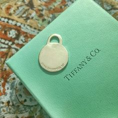 Tiffany & Co. blank pendant Shows sign of wear. Tiffany & Co. Jewelry
