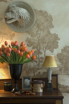 The master bedroom in Barry Dixon's home, Elway Hall, features a painted mural of the surrounding countryside.The plaster wolfhound is from an old French château.