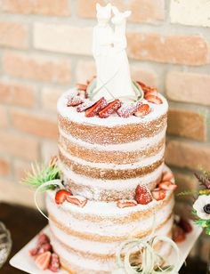 Vanilla/strawberry Naked cake by Dolce Designs in Houston