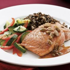 Lime juice, chili powder and pepitas give this salmon Mexican flair. Serve with wild rice and steamed vegetables.