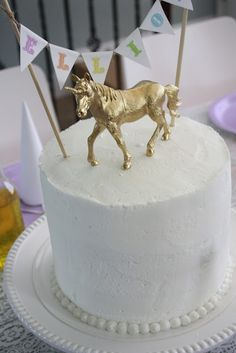 dollar store horse + screw + hot glue gun + gold spray paint = most amazing unicorn topper ever!