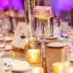 Wedding decor idea: Candle holders with a single rose submerged