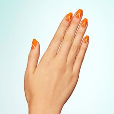 11 matte nail inspiration ideas: Start with a neon orange base, then add an inverted-V to each nail. Once dry, set the look with a matte topcoat. Design by @paintboxnails