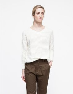From Farrow, a super-soft semi-sheer sweater with texture tick stripe patterning.