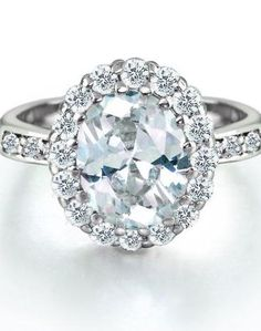 Budget engagement ring tip...buy a nice sized cubic zirconium, then get the real thing later, when you have more money. Sterling Silver 4ct Oval CZ Engagement Ring #MayWeddingPhotoChallenge