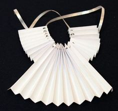 Accordian Folded Paper Angel Ornament Step 9 thread ribbon through holes- This would look great using paper doiliesThe Easy Angel Crafts accordian folded paper angel ornament is easy, fun and inexpensive to make. Diy Christmas Tree Topper, Christmas Tree Angel, Christmas Tree Ornaments, Christmas Decorations, Xmas Trees, Paper Decorations, Christmas Origami, Christmas Paper, Kids Christmas