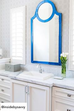 The Howard Elliott Norfolk Mirror is shown here in a bathroom designed by Inside by Savvy Interior Design. Unfortunately this mirror is no longer in our line, but we couldn't help but show you how beautifully it works in this bathroom.   #howardelliottmirror #bluemirror #modernmirror #bathroommirror