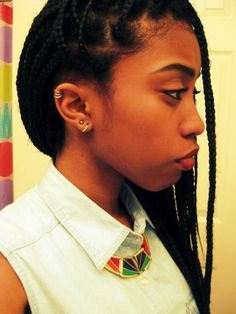 My parts are going to be this big if I get my hair braided again. I like her cartilage ring too.