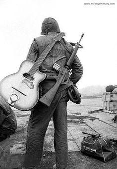 VIETNAM ERA SOLDIER - M-16 AND GUITAR