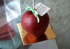 """The """"apple"""" is a vanilla marshmallow; ethereal is best description, airy and fragrant with vanilla beans. The entire thing is dipped in a milk chocolate shell, painted a deep red and tied with a ribbon leaf. What more could you want?"""