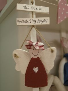 "Wooden Angel Plaque with the words ""This home is protected by angels"" Designed & made by Oopsy Daisies"