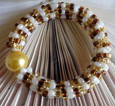 #spiralgoldbracelet #seedbeadsbracelet #infinitybracelet #eternitybracelet #herringbonebracelet #etsyhop #etsyseller #etsyfinds #etsylove #etsymontreal #etsycanada #beadedbracelet #noclaspbracelet