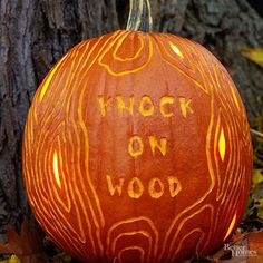 Make trick-or-treaters take a second look with this clever pumpkin carving designed to look like a spooky tree trunk. Carve the pumpkin: Download the free pattern and transfer it onto your pumpkin. Use a gouging tool to carve the words and wood grain; use a knife or carving tool to cut out the knots./