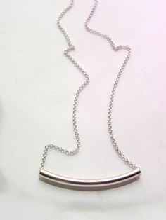 Silver necklace.