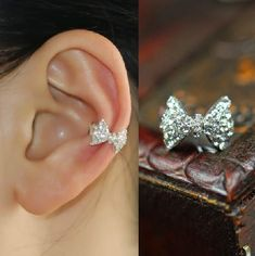 Normally I don't like ear cuffs but this one is really cute. Sparkly Bow Rhinestone Ear Cuff (Single) | LilyFair Jewelry, $9.99!.............um I want one
