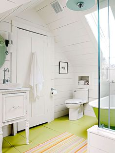 Vintage Cottage  Optimization is Key  The room's slim 8x12-foot dimensions are maximized by a clever floor plan. A built-out wall under the eave offered space for the toilet and a built-in, 10-inch-deep storage cubby behind it.