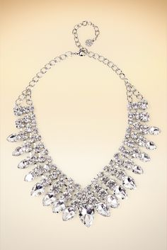 A jeweled showpiece with faceted crystals in variegated shapes and sizes, this necklace will become a timeless classic.