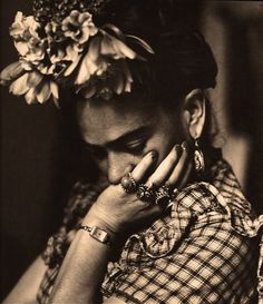 Frida- for Halloween I dressed up like her an just donning the flowers and costume I felt vibrant, feminine and powerful. This picture reminds me of those things