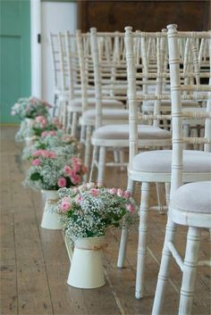 Line your aisle with jugs of flowers #springwedding