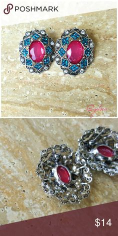 Vintage style turquoise and magenta studs Rich blue crystals surround the magenta center on a detailed hollowed out pattern. Durable but not heavy. Discounts given on bundles. Salty Grace  Jewelry Earrings
