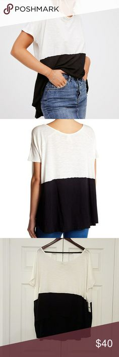 "Free People | Midnight Colorblock Tee Super soft and relaxed tee with unfinished edges for an effortless lived-in look. Bottom contrast color detail.  We The Free  Could easily fit an XL  - 60% Cotton, 40% Modal - Machine Wash Cold - Length: 22"" - Sleeve Length: 10.5"" Free People Tops Tees - Short Sleeve"