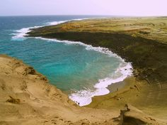 Green Sands, South Point, Hawaii.  The sand is made up of tiny grains of the gemstone peridot in the caldera of an extinct volcano...